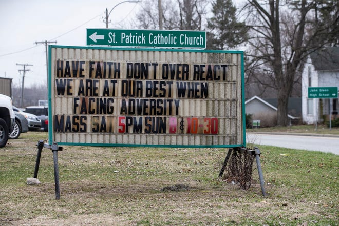 """ABOVE: A church sign in Walkerton reminds people to have faith and not to over react. RIGHT: A person walks by a mural that reads """"Hope Grows"""" along Jefferson Street, near Niles Ave., on Friday in South Bend."""