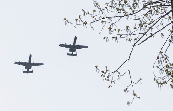 Two A-10s perform a flyover south of downtown South Bend on Tuesday, May 5, 2020.