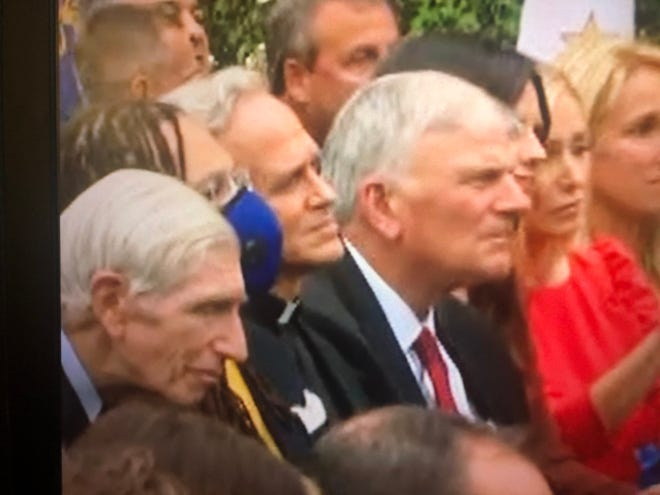In this video screen grab posted by WSBT, Notre Dame's president, the Rev. John I. Jenkins, is seen without a mask and in close proximity to other attendees last Saturday at the Rose Garden ceremony for Amy Coney Barrett. Late Monday afternoon, Jenkins apologized for not following COVID-19 safety protocols during the ceremony.