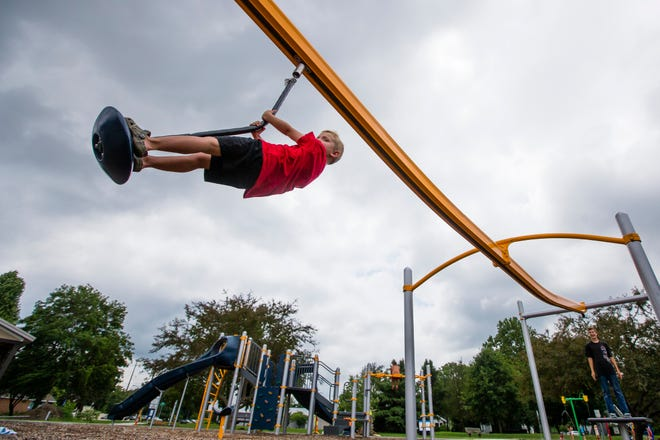 Bentley Anderson, 5, plays on a piece of equipment Thursday, July 16, 2020 at Twin Branch Park in Mishawaka.