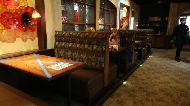 On the first day restaurants could open in Indiana to dining room seating, precautions are set forth on tables Monday inside Papa Vino's restaurant on Main Street and Edison Lakes Parkway in Mishawaka.