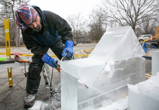 Dean de Marais sculpts a table game for the Hunter Ice Festival on Tuesday January 14, 2020 in Niles.