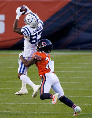 Indianapolis Colts wide receiver Marcus Johnson (83) makes a catch against Chicago Bears cornerback Buster Skrine at Soldier Field in Chicago Sunday.
