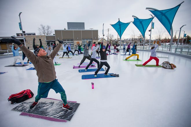 Guests do one of the many poses during the Yoga on Ice session Saturday at Howard Park.