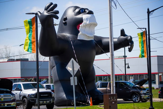 A large blowup gorilla with a mask on it Friday, May 8, 2020 at R&B Car Company in South Bend.