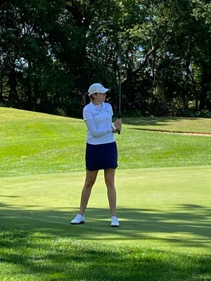 Kim Kaufman watches her birdie putt effort at Blackthorn Golf Club's 14th hole in Friday's first round of the Four Winds Invitational, an event on the LPGA Symetra Tour.