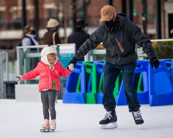 Bo Ennis skates with his 4-year-old daughter Brielle Friday, Dec. 18, 2020 at Howard Park in downtown South Bend. Every Friday, there are two kids-only sessions in the afternoon where adults must have a child to skate.