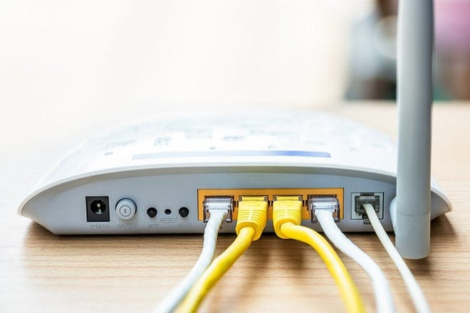 An internet modem with cables attached.