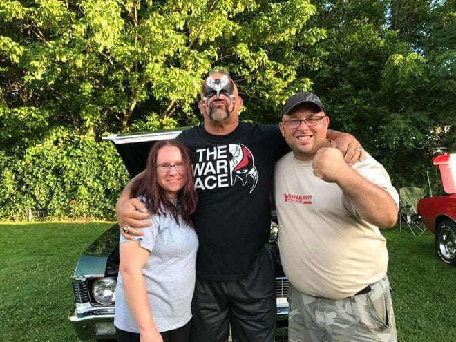 """Mike Rose Jr., far right, with his wife, Jen, and pro wrestlerJoe """"Road Warrior Animal"""" Laurinaitis at a Rolling Thunder Motor Cruise in Jerome. Rose organizes the event each year to raise money for those in need."""