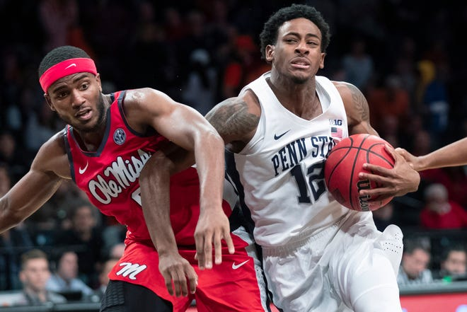 Penn State guard Izaiah Brockington (12) drives against Mississippi guard Blake Hinson during the second half of an NCAA college semi final basketball game in the NIT Season Tip-Off tournament, Wednesday, in New York. Mississippi won 74-72.
