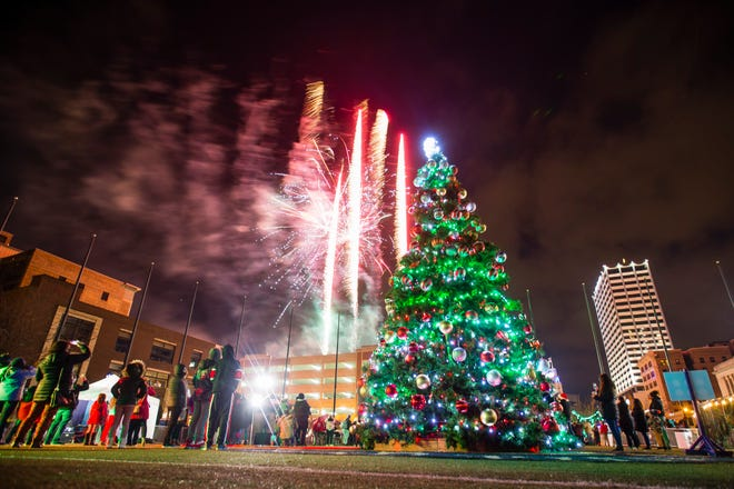 Fireworks explode during the tree lighting ceremony on Friday in downtown South Bend.