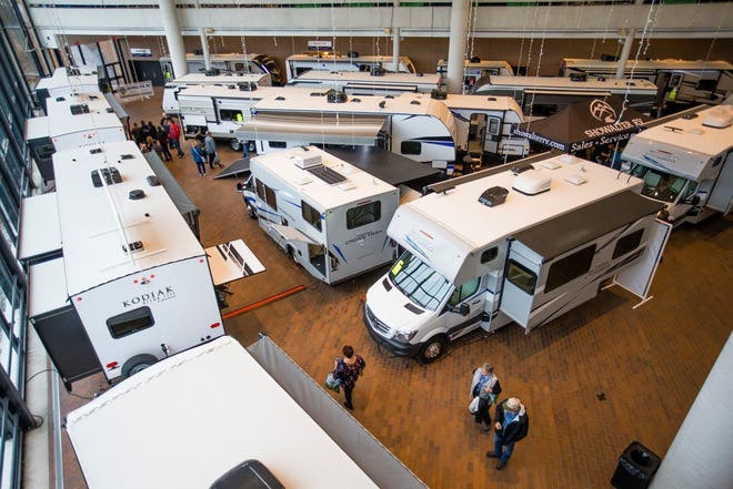 Guests look at RVs during the Valley RV and Camping Show Saturday at Century Center in South Bend.