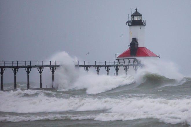 Lake Michigan waves hit the pier Monday, Nov. 30, 2020 at Washington Park Beach in Michigan City.
