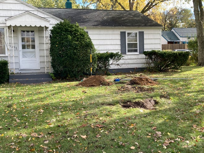 This is the house at the northeast corner of Ironwood and Bulla roads in South Bend, where a car crashed after hitting and killing two Notre Dame students last fall.