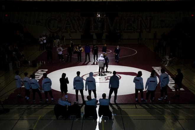 Wrestlers are announced between matches during the sectional wrestling meet.