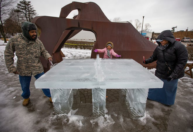 Jacquelynn Barnes, 5, cheers as her parents David and Sharlynn play ice ping pong during the Hunter Ice Festival Saturday, Jan. 18, 2020 in Niles.