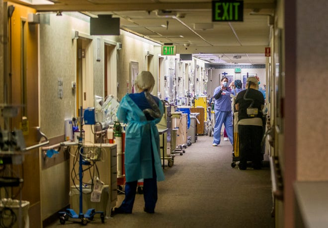 Medical workers walk the halls inside the COVID-19 unit.