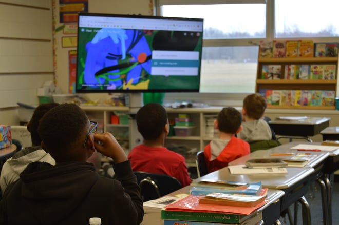 In this photo from 2020, fourth grade students watch a video that reviews how Google hangouts are used for learning at Tarkington Elementary School in South Bend.