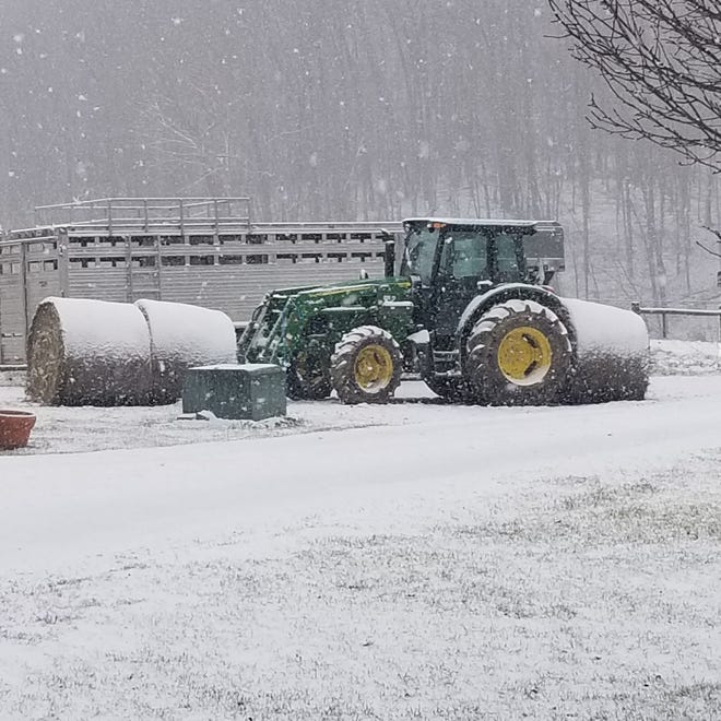 Jeff Sherfield, owner of Fescue Farms on Texas Pike, shared photos from his farm during the recent snow event to hit Owen County. The snow is particularly picturesque as it adorns Sherfield's hay bales and farm equipment. (Submitted / Spencer Evening World)