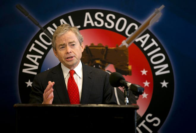 Then-Texas Sen. Don Huffines speaks during a 2015 news conference in Austin. Huffines, who has sharply criticized the state's handling of the pandemic, said Monday that he will challenge Republican Gov. Greg Abbott next year.