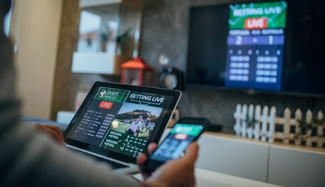 Sports betting on a tablet and TV