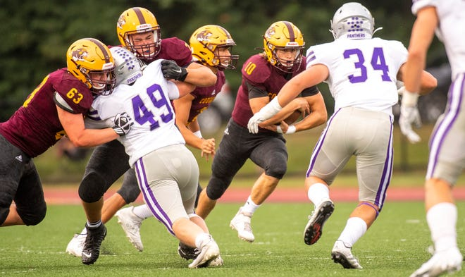 Bloomington North's Cody Mikulich (10) runs during the Bloomington North versus Bloomington South football game Friday, September 11, 2020. (Rich Janzaruk / Herald-Times)