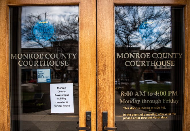 A closed until further notice flyer is seen on a Monroe County Courthouse door in downtown Bloomington on March 17, 2020. County boards and commissions began conducting meetings on Zoom. (Rich Janzaruk / Herald-Times)