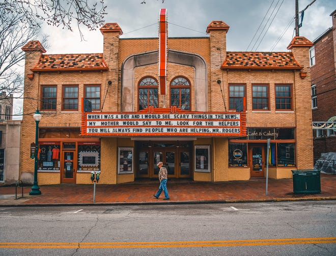 A man walks past the Buskirk-Chumley Theater on Kirkwood Avenue on March 20, 2020. (Rich Janzaruk / Herald-Times)