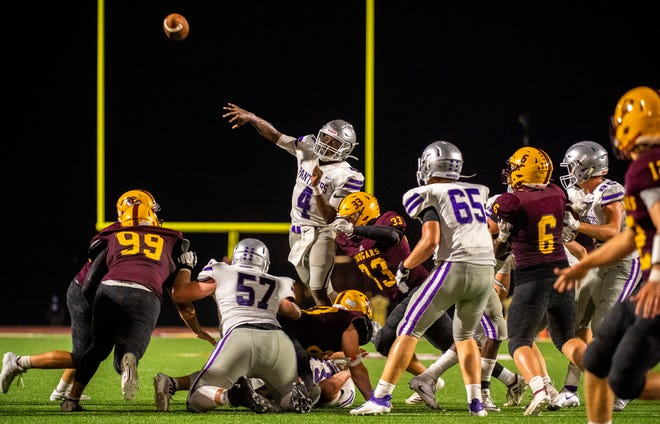 Bloomington South's D.J. Bull (4) throws a pass in overtime during the Bloomington North versus Bloomington South football game Friday, September 11, 2020. (Rich Janzaruk / Herald-Times)