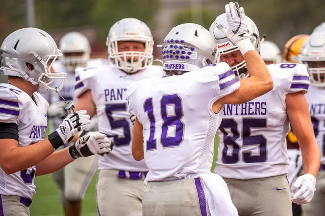 Bloomington South's Maddix Blackwell (18) celebrates his touchdown with Tysen Smith (85) during the game against Bloomington North in 2020.  Smith returns at tight end for the Panthers, who were ranked ninth in the IFCA preseason 5A poll.