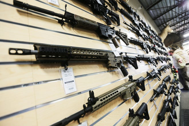 AR-15 rifles are displayed at Impact Guns in Ogden, Utah, on March 2, 2018. Scott G Winterton, Deseret News (courtesy)