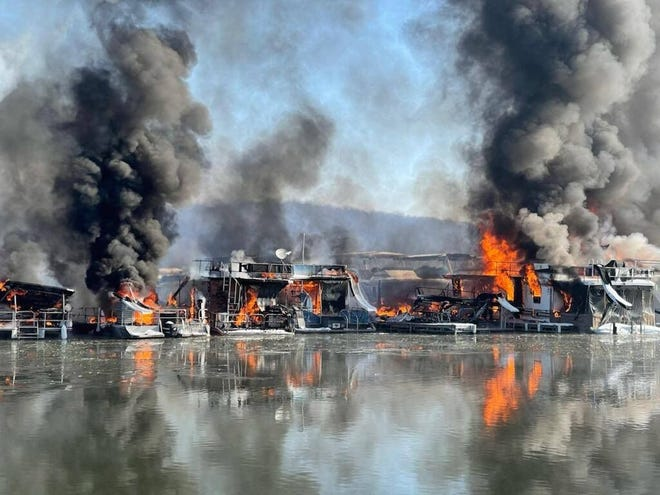 A fire that started on one houseboat at Hoosier Hills Marina on Patoka Lake Friday morning quickly spread to other nearby craft.