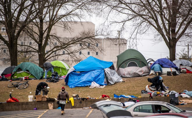 A homeless encampment is seen behind the post office near Seminary Park on Dec. 24, 2020.