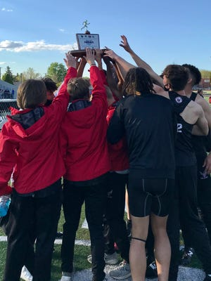 The Marion Harding boys track team celebrates its first Mid Ohio Athletic Conference Track and Field Championships title Thursday night at Harding Stadium.