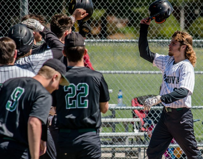 Monrovia senior Ben Dalton celebrates with his team as he crossed home plate after his second inning solo home run against Brown County on Saturday, May 8, 2021. (Eric Scott Miller / Correspondent)