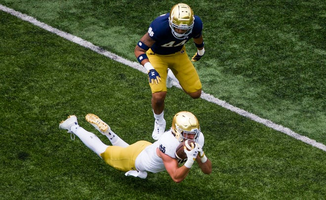 Former Notre Dame defensive end Devin Aupui, above, defends Irish tight end George Takacs during the 2021 Blue-Gold Game in May. Aupui announced Monday evening he plans to transfer to UCLA.