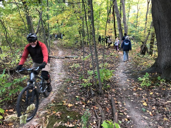 A hike Thursday, Sept. 30, will return to Chikaming Township Park and Preserve, honoring the birthday of the late Kirk Schrader who created the mountain bike trails there. Seen here is the hike/bike ride held last year on this date.