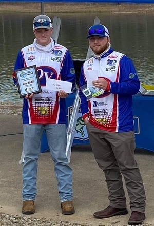 Owen Valley's Wyatt Beuerlein, left, and Clay Meek, right, competed in the Indiana Bass National High School tournament at Patoka Lake recently, finishing fourth with a 7.68 pound bass. The fish was caught by Beuerlein on his third cast of the day, using a Secret lures tube. (Submitted / Spencer Evening World)