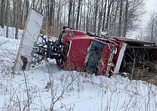 Snow-covered roads are dangerous… even for plow drivers. New snowfall and slick roads claimed another… the Owen County Highway Department was busy plowing rural roadways when this accident occurred. The driver, according to the Highway Department, was uninjured. Please give plow drivers ample room to operate and make roads passable. (Submitted / Spencer Evening World)