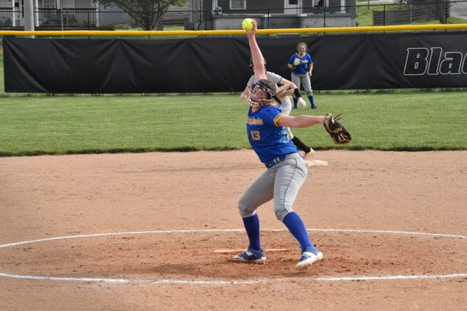 Josie Campbell winds up before uncorking a pitch against Springs Valley. The senior was superb for Mitchell in the win, striking out eight batters in five innings. (Auston Matricardi / Times-Mail)