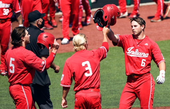 Indiana's Grant Richardson (6) celebrates with Drew Ashley (3) and Paul Toetz (5) after hitting a home run during Sunday's game against Minnesota at Bart Kaufman Field. (Bobby Goddin / Herald-Times)