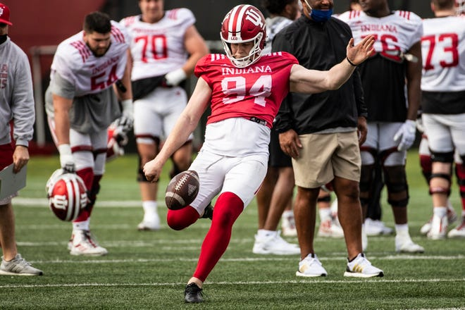 Punter James Evans (94) takes part in an Indiana spring practice at the practice fields outside of Memorial Stadium on April 6. (Missy Minear / Indiana Athletics)