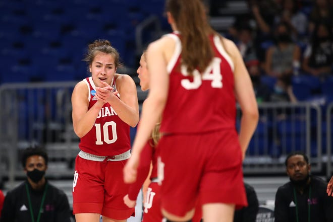 Indiana's Aleksa Gulbe (10) claps in encouragement at her teammates during the Hoosiers' 73-70 win over N.C. State in the Sweet 16 of the NCAA Tournament at the Alamodome in San Antonio on Saturday night. (Justin Tafoya / NCAA Photos via Getty Images)