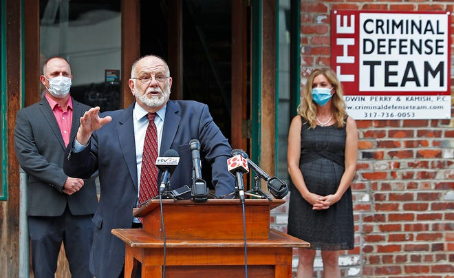 Attorney David Hennessy speaks on behalf of Sean Purdy, left, and Caroline McCord, right, outside The Criminal Defense Team offices in Indianapolis July 13, 2020, about the incident in which his clients are accused of a racial attack on Vauhxx Booker on July 4, 2020, at Lake Monroe.