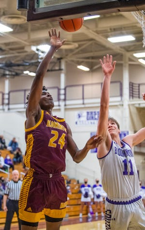 North's JaQualon Roberts (24) goes up for a shot over South's Joey Bomba (11) during the Bloomington North versus Bloomington South sectional final at Bloomington High School South Saturday, March 6, 2021. (Rich Janzaruk / Herald-Times)