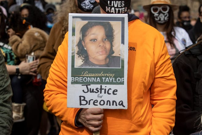 A sign for Breonna Taylor is held during a protest in Louisville March 13 on the anniversary of Breonna Taylor being killed in her apartment by LMPD officers. (Alton Strupp / USA Today Network)