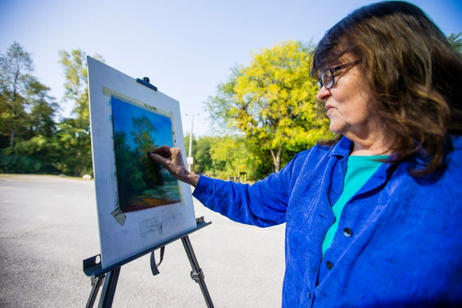 Cathy McCormick works on a pastel piece of art Thursday, Sept. 24, 2020 at Saint Patrick's County Park in South Bend. McCormick hosts a socially-distant paint out every Thursday at the park, weather depending, for artists to gather and create. There is no gate fee at the park on Thursdays and artists should bring their owns supplies to create.