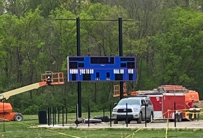 ABOVE: Out with the old and in with the new... The old Owen Valley scoreboard came down recently with the new scoreboard starting to be put up Tuesday evening. (Amanda York / Spencer Evening World)