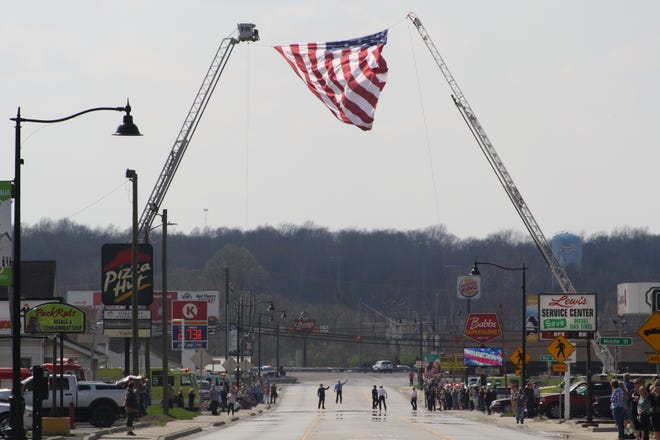 The flag fluttered in the breeze as the funeral procession for fallen Monroe County Reserve Sheriff's Deputy and Spencer resident James A. Driver made it's way through town Tuesday evening. (Submitted / Spencer Evening World)