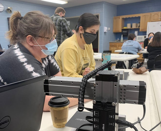 OVMS Custodian Davetta Fidler and FFA teacher Shelby Wolford work together to create a design on Tinkercad software in preparation to use on a Snapmaker machine. Snapmakers are a 3-in-1 machine that can be a CNC router, laser, and 3D printer. (Submitted / Spencer Evening World)